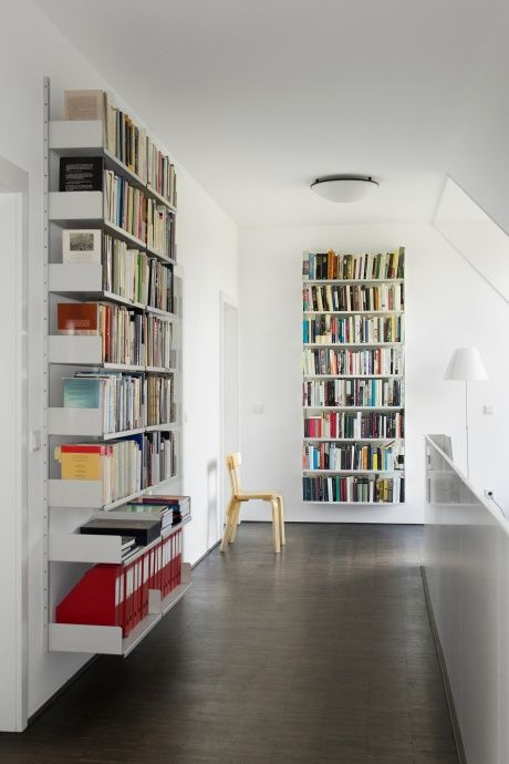 Books over art. This library makes fine use of a first-floor landing. The 606 Universal Shelving System designed by Dieter Rams for Vitsœ in 1960
