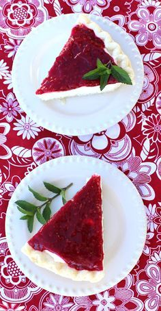 Raspberry Cream Pie from Jamie Cooks It Up! A fabulous fluffy cream cheese filling is topped with a homemade raspberry sauce to make this fabulous pie!