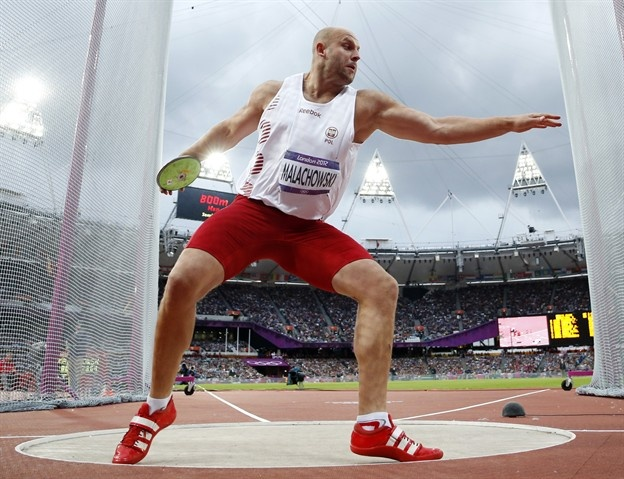 Day 11: Evening Session - Track & Field Slideshows | Poland's Piotr Malachowski takes a throw in the men's discus throw final during the athletics in the Olympic Stadium.  (Photo: Matt Dunham / Associated Press) #NBCOlympics