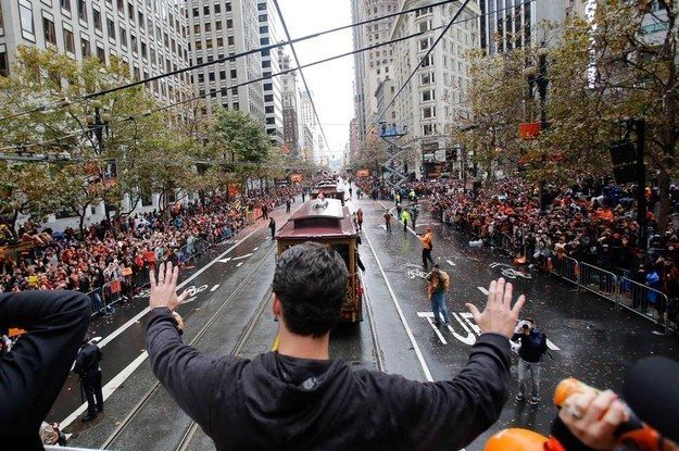 Gerald Dempsey Posey III (AKA Buster) with his kingdom. | 11 Of The Most Glorious Photos From The Giants World Series Parade
