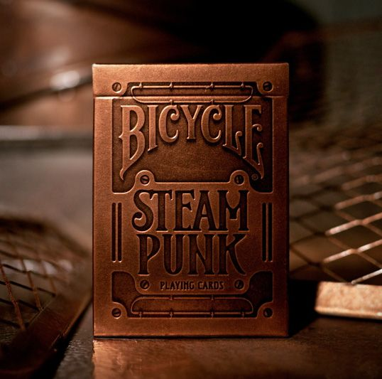 Copper paper, stamp for Bicycle Steam Punk playing cards debossed on surface. Designed by Alex Beltechi to resemble 19th century Victorian machinery.