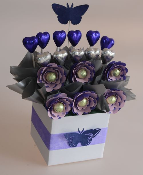 A lovely bouquet with solid chocolate hearts and roses with solid chocolate balls