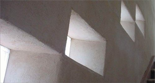 A photo of an interior wall constructed from autoclaved aerated concrete. It has…