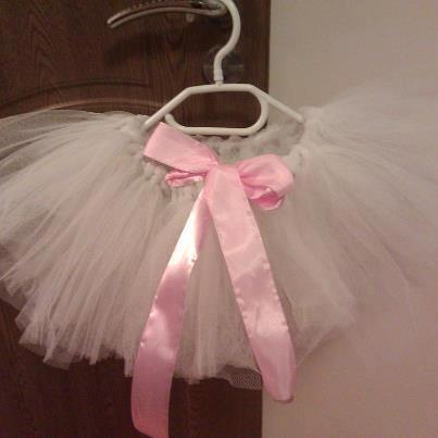 white tutu with pink ribbon