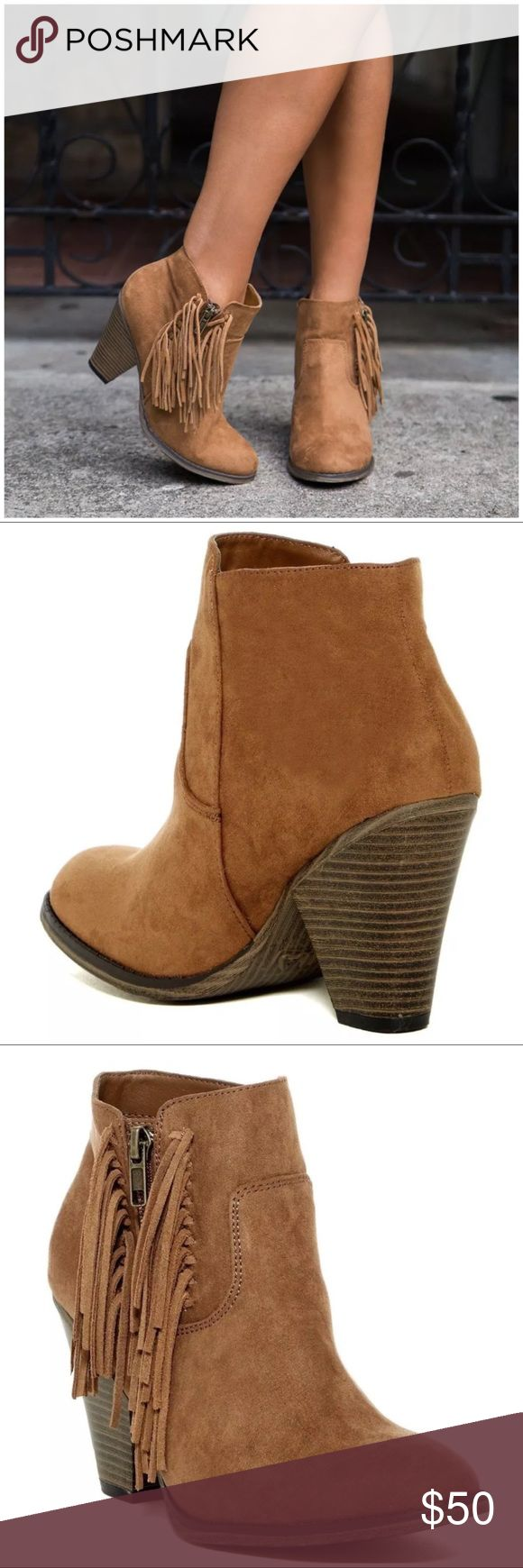 "Tan Suede Fringe Stacked Chunky Heel Bootie Western-inspired side fringe detail completes a soft textured bootie lifted on a wooden heel.  Sizing: True to size. Standard width   - Round toe - Vegan suede with genuine suede fringe detail - Side zip closure - Stacked print chunky heel - Approx. 3.5"" shaft height, 9"" opening circumference - Approx. 3.5"" heel - Imported Shoes Ankle Boots & Booties"