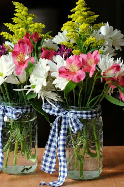 Gingham Scraps Arrangement: This easy-to-make flower arrangement could be your next go-to gift. Just tie a piece of gingham fabric around your Mason jar and add a bouquet. Click through to find more pretty mason jar flower arrangements to try this summer.