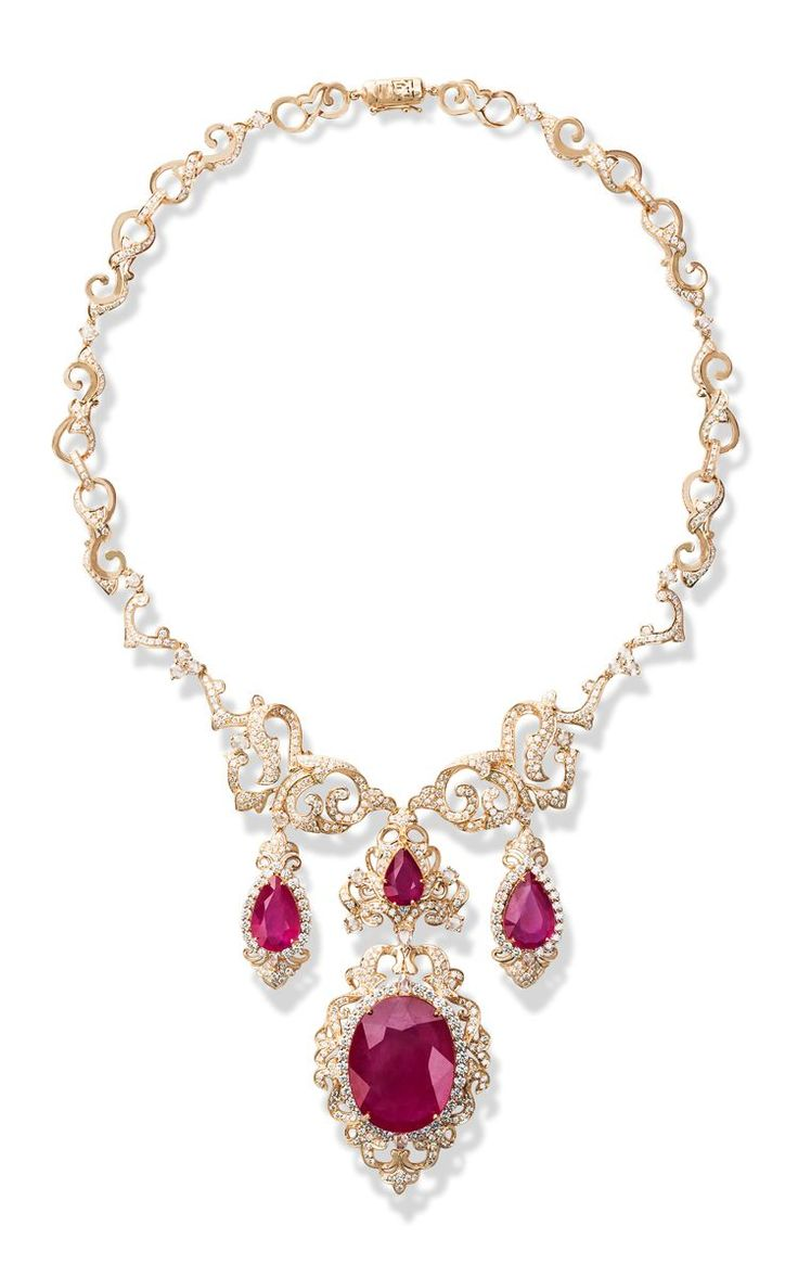 FARAH KHAN FINE JEWELRY Regal Romance Necklace. Rendered in yellow gold, this necklace by Farah Khan features three rows of glass filled ruby pendants surrouned by white diamonds.  Slips on 18K Yellow Gold White Diamonds, 11.78 cts Rosecut diamonds, 3.05 cts Glass filled rubies, 85.13 cts Made in India  $44,100 ($22,050 deposit)