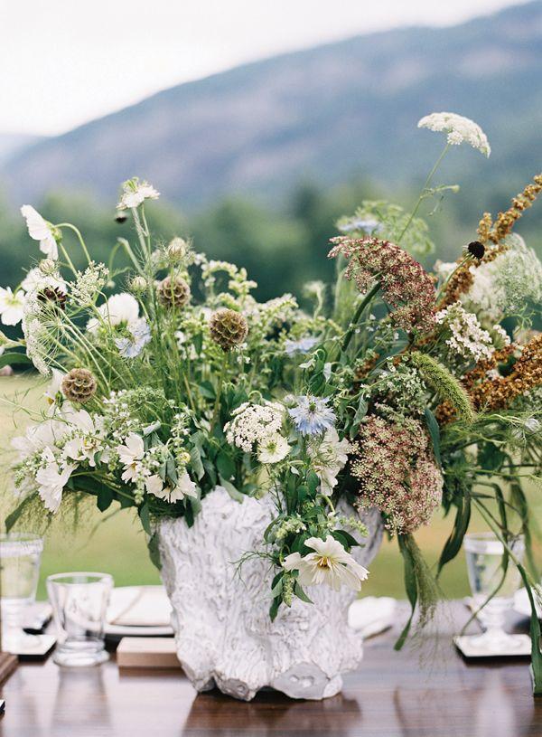 wildflower centerpiece in a faux bois vase   Graham Terhune