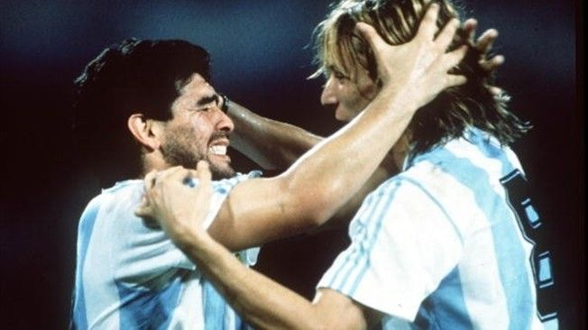 Argentina's Claudio Caniggia celebrates with an emotional Diego Maradona after the match against against Romania during the 1990 World Cup Finals