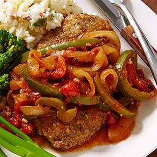 This weeknight-fast Swiss steak recipe is made on the stovetop in just 30 minutes (traditional Swiss steak braises in the oven for an hour or more).