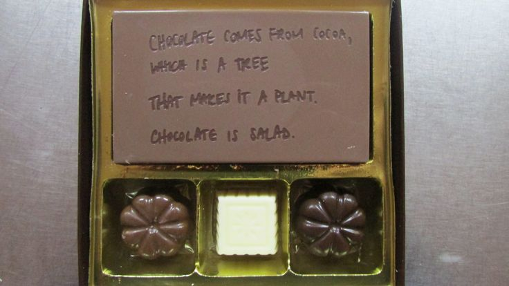 Small gift box of engraved & filled chocolates.