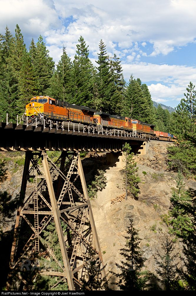 At 5 o'clock in the afternoon a Tacoma bound stack train working toward the Cascade summit steps across the Nason Creek trestle. This location is about 46 rail miles west of Wenatchee.