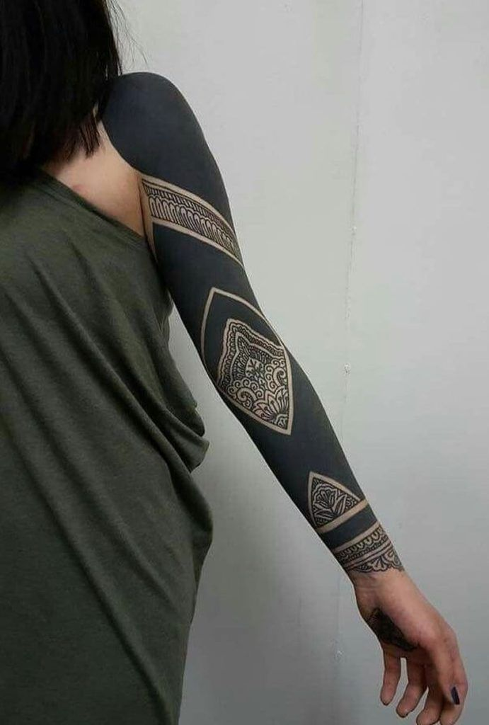 These Striking Solid Black Tattoos Will Make You Want To Go All In Kickass Things Black Sleeve Tattoo Black Tattoos Solid Black Tattoo