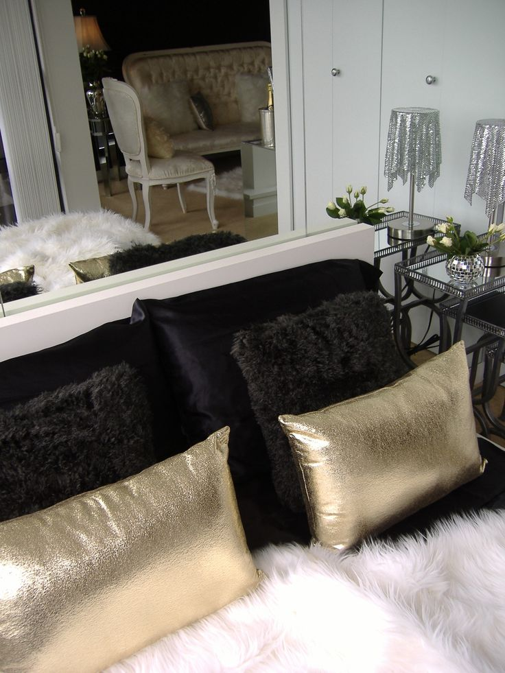 Gold finger inspired bed dressing... black satin sheets, black fur & gold  toss pillows & white fur throw