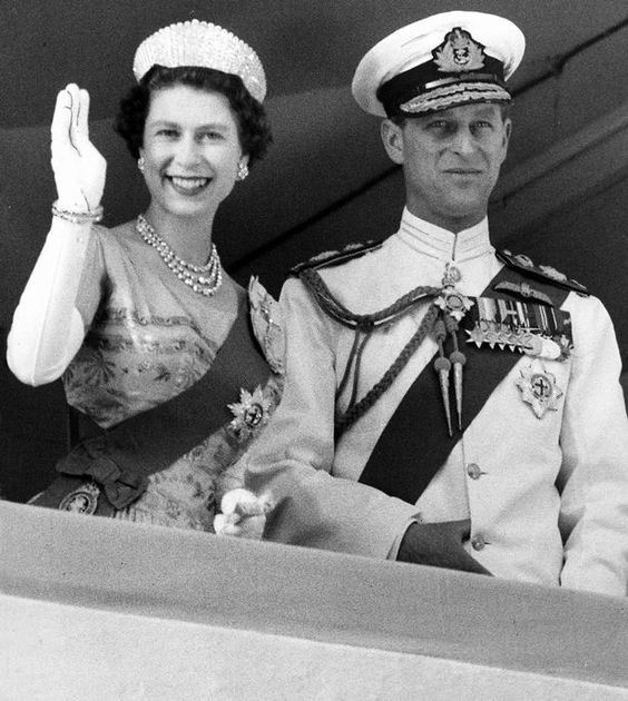 Queen Elizabeth II and Prince Philip waving at Kaduna, Nigeria during the Royal tour of Africa, 1956