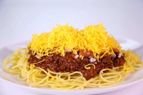 the chew | Recipe  | Michael Symon's Cincinnati Chili With Spaghetti I cannot believe this recipe has been found!!!!  At Skyline Chili in Fl this was a recipe locked in a Bank Vault!!!  Over spaghetti, On Hot Dogs...people came from miles away :)