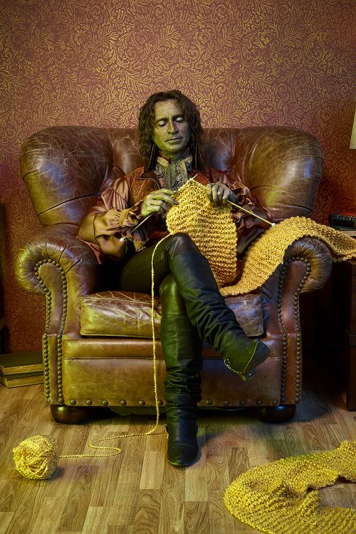 Is it bad that the first thing I think of is how much I like his boots? (The second is that his needles are too thin for that yarn, and the third is that I'd like to have a chair like that to knit in.)