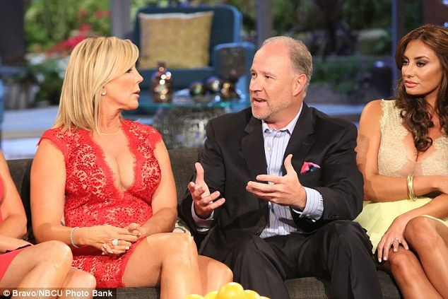 Confessed! Brooks Ayers, pictured with then girlfriend Vicki Gunvalson on Real Housewives Of Orange County Reunion Show in 2014, admitted Wednesday he'd faked medical bills to try and prove he has cancer