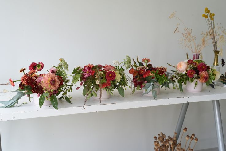 February Wedding, table flowers, centrepieces, red, pink, dahlias, roses, zinnias, Queen Anne's Lace, scented geranium