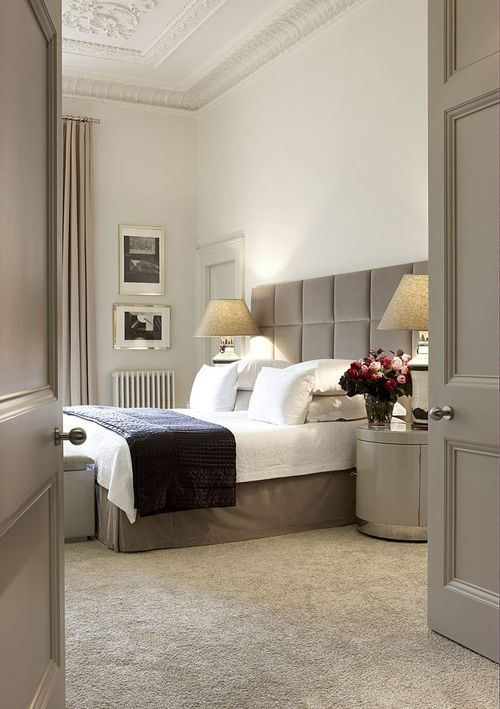 clean, white bedding with gray accents.