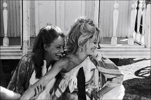 Brigitte Bardot and Jeanne Moreau laughing together