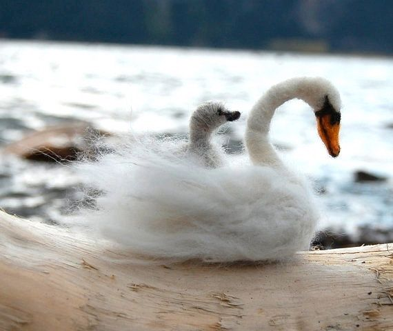 ~Motherly Love~ This Beautiful swan sits 3.5 tall and is 3.5 long. The baby cygnet swan is 1x1. They are so soft to the touch and fit perfectly in the