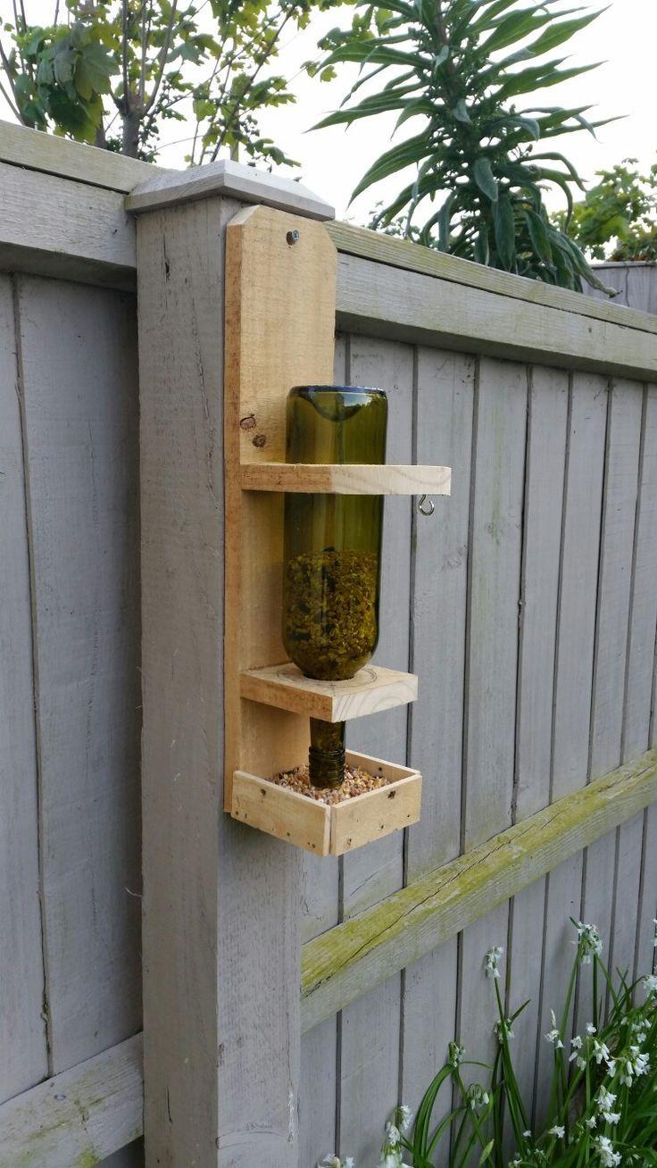 Pallet wood and wine bottle bird feeder.