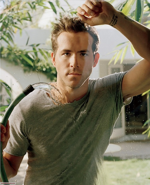 ryan reynolds... Love him,! But think of how funny this photo shoot would have been. Hey Ryan, grab this hose and hose yourself down while staring meaningfully into the camera. But, wow, we still love it.