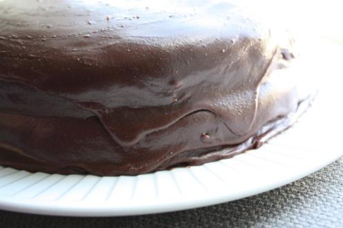 Chocolate Fudge Icing: 1 cup sugar 1/4 cup cocoa 1/4 cup butter 1/4 cup milk 1 tsp vanilla In a stove top pot, combine all and over medium heat, bring to a boil. Boil for 2 -3 minutes. Let cool completely (30 minutes to an hour). Once cool, beat until the consistency becomes fudge like, but not too hard. Mix in vanilla and spread over cake. Enjoy!
