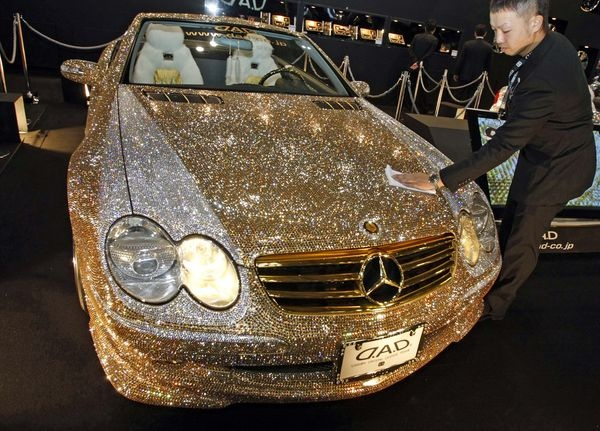 Gold car bling…. Over the top but who cares?!