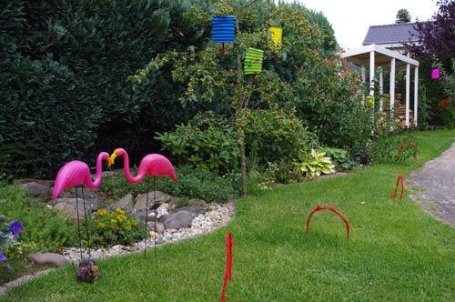 Lawn flamingos, hoops and a stuffed animal hedgehog - ready for flamingo croquet!