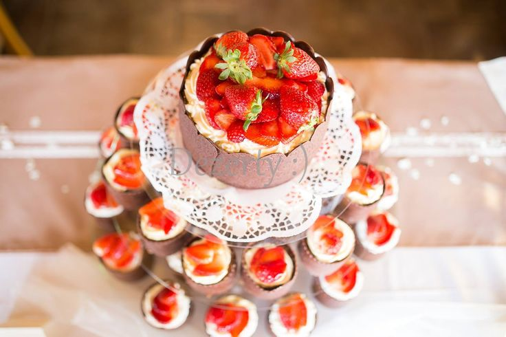 Wedding cake from cupcakes with strawberries
