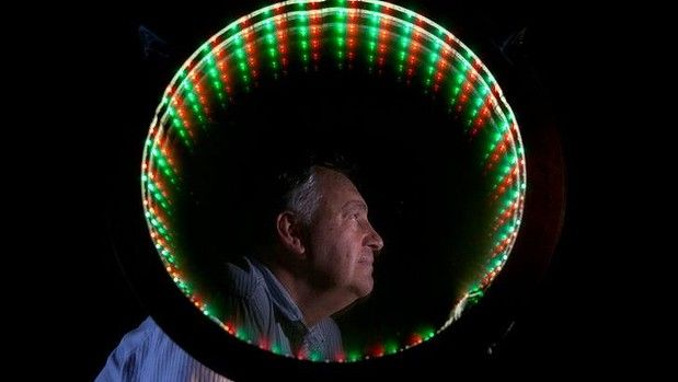 In the Frame, created for the Vivid Sydney festival, features three mirrors illuminated with LED light sources that allow viewers to peer through or admire themselves in a reflection that never ends.