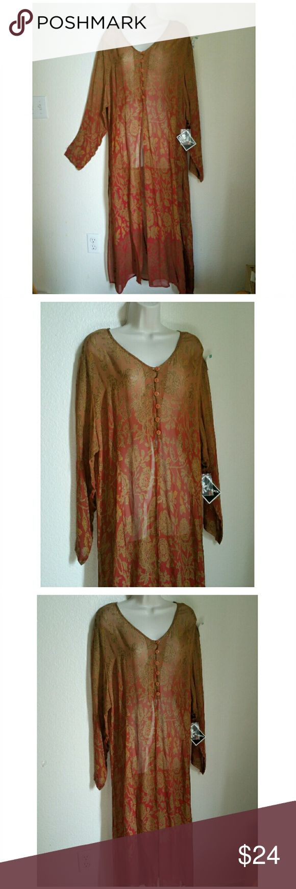"""Long Floral Tunic - NWT Absolutely new! This long semi-sheer floral tunic is a great accent piece for a neutral palette.  Dress up or casual, wear with jeggings and heels or jeans and boots, or festival wear. Phool, size 1X, 100% rayon, made in India. 22"""" pit to pit. Rust and coppery-brown color print.  Deep set sleeves. Five buttons at bust. V-neckine. Deep side splits. Long sleeves. New, with tag and extra button pouch. Phool Tops Tunics"""