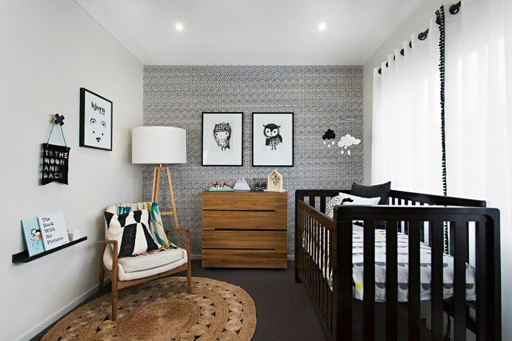 black white and brown kids nursery with feature wallpaper and dark brown cot