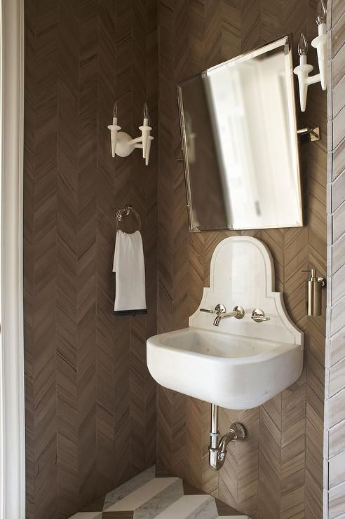 White And Brown Powder Room Boasts Walls Clad In Brown