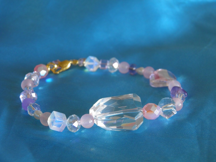 Channeled bracelet with rose quartz, amathyst and crystals.