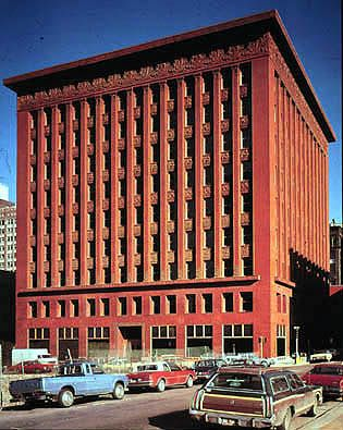 "Wainwright Building, St Louis, by Adler and Sullivan.  ""Forms follows function""  Classic skyscraper. Steel frame, large ground floor windows. Consists of basse, middle section, and a top. Mechanical systems are hidden on the top floor behind the large cornice. Ornate terracotta spandrels adorn the frieze and roof. Subtle Art Nouveau."