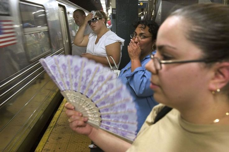 NYC's Hottest Subway Stations, Mapped   Elena Kobzarenko of Brooklyn fans herself while waiting for a subway, with temperatures hitting the upper 90s.