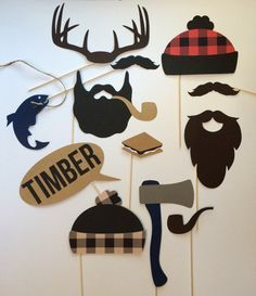 LUMBERJACK PHOTO BOOTH PROPS (12 pieces)<< Celebrating the outdoorsman in your life? These photo props are perfect for a lumberjack or camping themed birthday party, baby shower! >>DETAILS: 12 pieces include: 1 brown mustache 1 black mustache 1 smore 1 hatchet 1 fish/pole 1 brown beard 1 black beard with pipe 1 pipe 2 hats, red and tan buffalo plaid 1 TIMBER convo bubble 1 set of antlers All made with durable card stock and a wooden dowel LUMBERJACK PARTY SET SOLD HERE (Includes this 1...