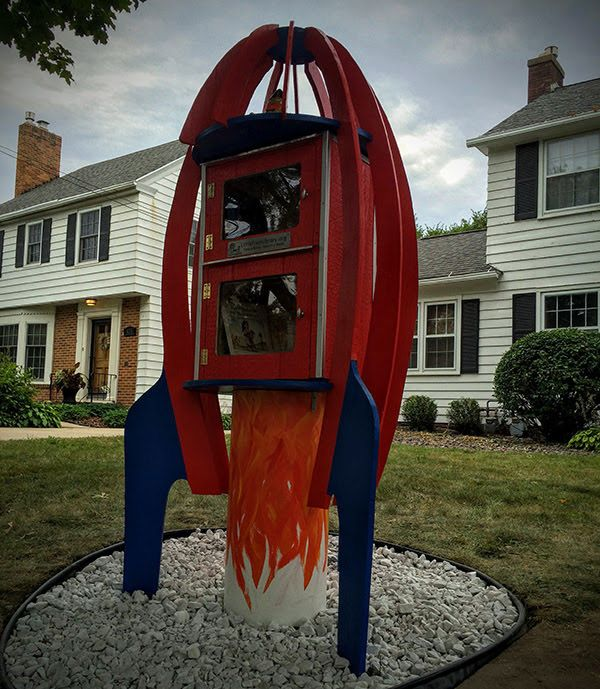 Ariel Borisch. Rochester, MN. My kids are always excited to find a Little Library with children's books, so when we designed ours to have 2 boxes--one for adults and one just for kids! We designed it to look like a rocket ship. When I asked my father-in-law, Don, if he could build me a Little Library, he was game even after I told him I really wanted it to be a rocket ship. He tells me he really enjoyed the design challenge and truly, what he created exceeded even my imagination.