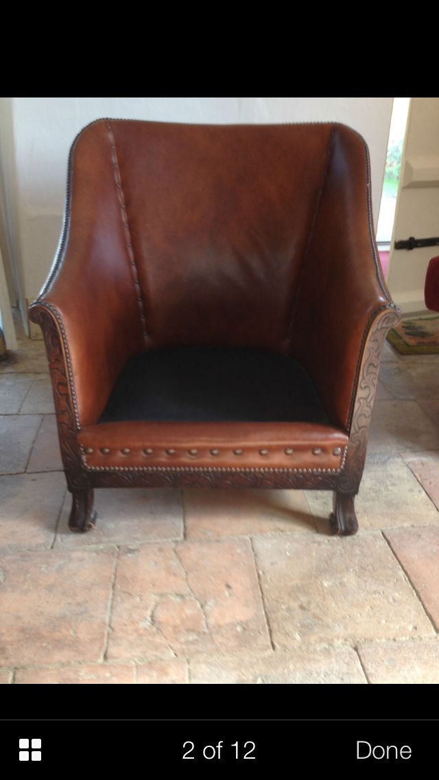 Beautiful old leather arm chair to fall asleep in after a hearty winter lunch and an afternoon snifter.