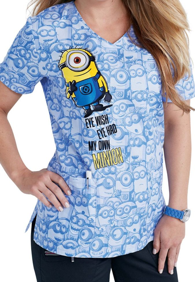 Generate lots of smiles in the office when you wear the My Own Minion top from Cherokee Tooniforms! This enjoyable top includes lots of storage space for your accessories with two large lower pockets and a cell phone pocket. The crossover design will flatter your figure and side slits are provided for ease of movement.