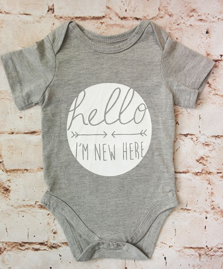 Hello, I'm New Here! Short sleeve gray onesie with white screen print. 100%…
