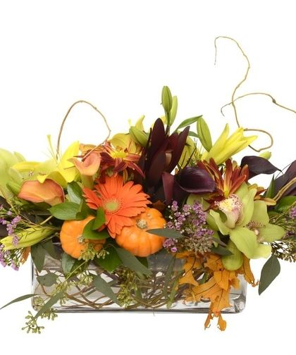 Featuring Autumn florals and accents including market mini pumpkins, willow, asiatic lilies, calla, orchids, and garden roses for #Thanksgiving.
