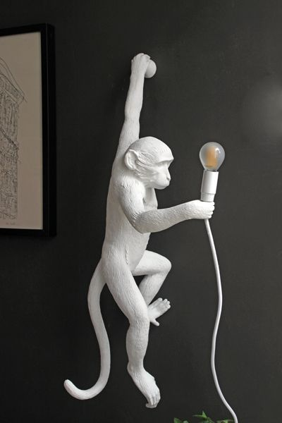 White Monkey Wall Lamp Crafted from resin and holding an LED bulb this charming monkey will boldy