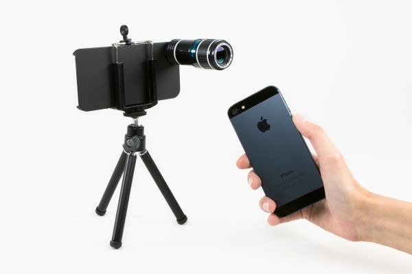The iPhone Telephoto Lens - This little (big) lens gives our humble cell phone shots uber-telephoto powers (8x-12x the powers to be exact). Powers we never thought possible with our dinky built-in lens. Photo is just with my own hand...   www.optake.com