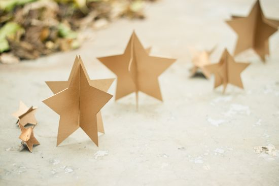 Holiday Gold Stars - I love how simple these stars were to make, and they can be used in so many different ways... -Christmas tree ornaments -Could be placed randomly on bookshelves -You could hang a grouping of them with clear string over a table top for a fancy holiday dinner -Make a bunch of tiny ones and fill glass candy/apothecary jars with them ...and I'm sure you could think of many more uses!