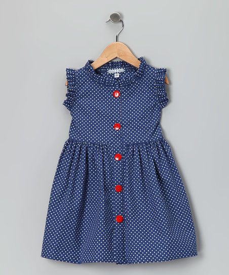 Any little fairy princess will flutter in this polka dot picnic dress. With super-soft material, resplendent ruffles and an easy button-up silhouette, this piece simply soars.