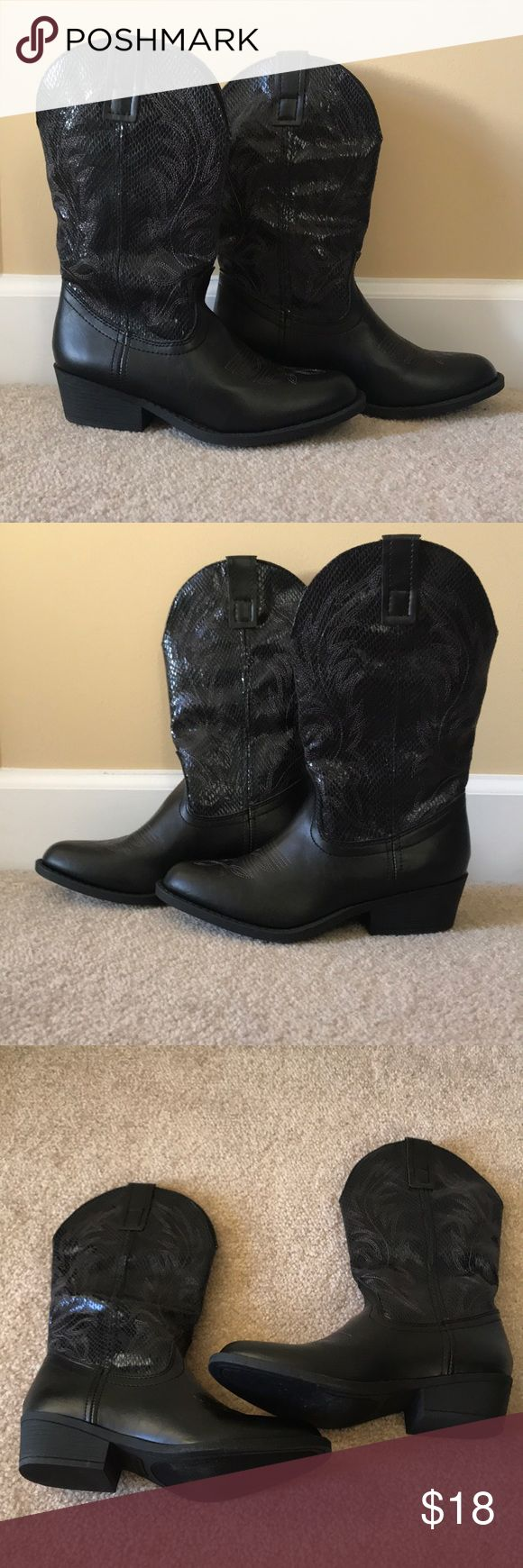 Ladies black cowboy boots Ladies Rampage black cowboy boots. Brand new, without tags. Never worn outside. Some carpet fibers on bottom from trying on. Excellent condition. Perfect for southern football game days, country concerts, or just whenever you want to wear them!! :) Rampage Shoes Heeled Boots